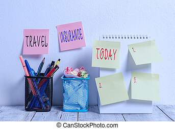 Word writing text Travel Insurance. Business concept for covers the costs and losses associated with traveling 6 Sticky Notes on Wall Open Spiral Notebook 2 Pencil Pots on Work Desk.