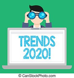Word writing text Trends 2020. Business concept for general direction in which something is developing next year Man Holding and Looking into Binocular Behind Open Blank Space Laptop Screen.