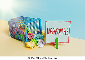 Word writing text Unreasonable. Business photo showcasing beyond right or acceptability boundaries or behaving in a way Trash bin crumpled paper clothespin empty reminder office supplies tipped