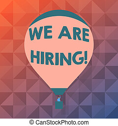 Word writing text We Are Hiring. Business concept for recently employ someone or pay him to do particular job Blank Pink Hot Air Balloon Floating with One Passenger Waving From Gondola.