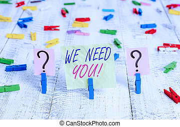Word writing text We Need You. Business concept for asking someone to work together for certain job or target Scribbled and crumbling sheet with paper clips placed on the wooden table.