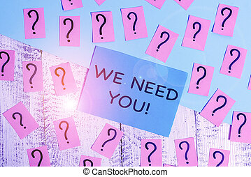 Word writing text We Need You. Business concept for asking someone to work together for certain job or target Scribbled and crumbling papers with thick cardboard above wooden table.