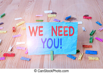 Word writing text We Need You. Business concept for asking someone to work together for certain job or target Colored clothespin papers empty reminder wooden floor background office.