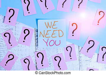 Word writing text We Need You. Business concept for Company wants to hire Vacancy Looking for talents Job employment Scribbled and crumbling papers with thick cardboard above wooden table.