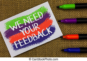 Word writing text We Need Your Feedback. Business concept for Give us your review thoughts comments what to improve Colorful waves with white page and texts color marker laid in line on jute sack.