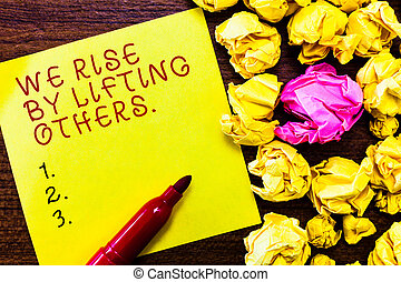 Word writing text We Rise By Lifting Others.. Business concept for Team Spirit we feel Abundant with possibility
