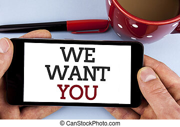 Word writing text We Want You. Business concept for Employee Help Wanted Workers Recruitment Headhunting Employment written on Mobile Phone Screen holding by man on the plain background Cup Marker