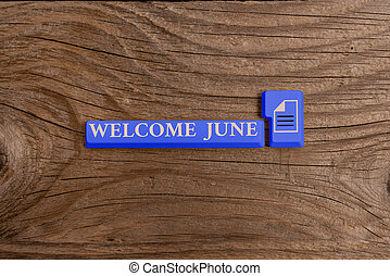 Word writing text Welcome June. Business photo showcasing Calendar Sixth Month Second Quarter Thirty days Greetings Different Colored PC keyboard key With Accessories on Empty background