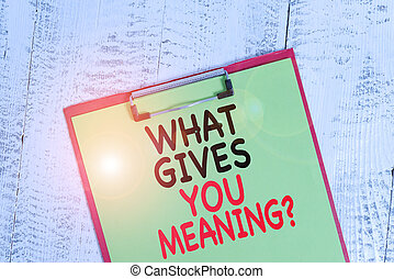 Word writing text What Gives You Meaning Question. Business concept for your purpose or intentions in life Colored clipboard blank paper sheet old retro wooden vintage background.