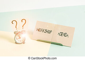 Word writing text Workshop Agenda. Business concept for helps you to ensure that your workshop stays on schedule Mini size alarm clock beside a Paper sheet placed tilted on pastel backdrop.