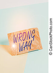 Word writing text Wrong Way. Business photo showcasing taking an unsuitable or undesirable analysisners or direction Paper placed tilted above buffer wire on soft pastel multi colours backdrop