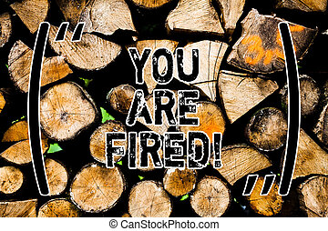 Word writing text You Are Fired. Business concept for Getting out from the job and become jobless not end the career Wooden background vintage wood wild message ideas intentions thoughts.