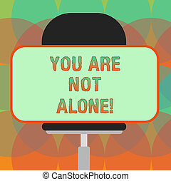 Word writing text You Are Not Alone. Business concept for Offering help support assistance collaboration company Blank Rectangular Shape Sticker Sitting Horizontally on a Swivel Chair.