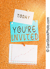 Word writing text You Re Invited. Business concept for make a polite friendly request to someone go somewhere Corkboard color size paper pin thumbtack tack sheet billboard notice board.