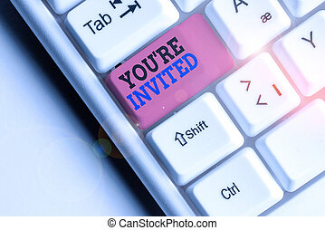 Word writing text You Re Invited. Business concept for Please join us in our celebration Welcome Be a guest White pc keyboard with empty note paper above white background key copy space.