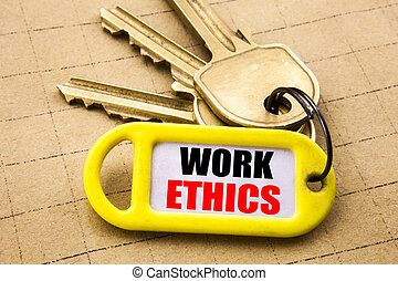 Word, writing Work Ethics. Business concept for Moral Benefit Principles Written on key holder, textured background close up.