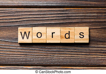 word written on wood block. WORD text on wooden table for your desing, concept