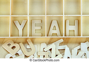Word yeah made with block wooden letters