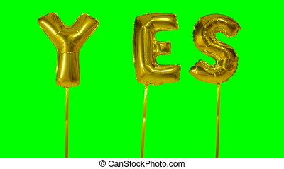 Word yes from helium golden balloon letters floating on...