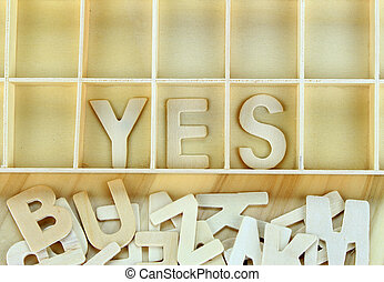 Word yes made with wooden letters alphabet