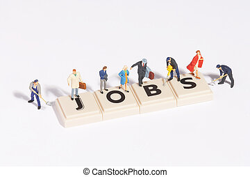 """jobs"" written of scrabble-stones with plastic figures around and on it"