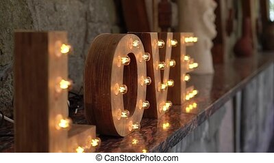 Wording Love sign with light bulb - Wording wooden Love sign...
