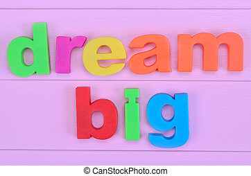 Words Dream Big on pink table