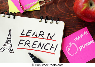 learn french - Words learn french written in the notepad.