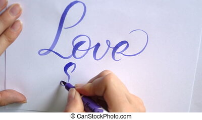 Words love story with blue ink brush calligraphy and lettering