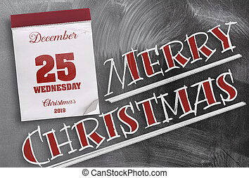 Merry Christmas on chalkboard with tear-off calendar on December 25