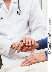 Words of consolation - A doctor giving a patient words of ...