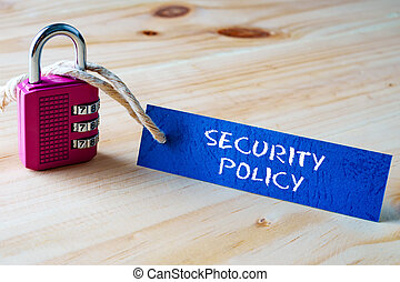 Words SECURITY POLICY written on tag label tied with a padlock.