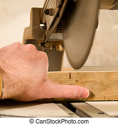 Work Accident - A sharp saw blade is going to cut of a ...