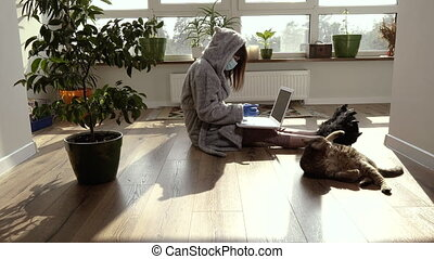 Work at home. A woman during quarantine works at home.