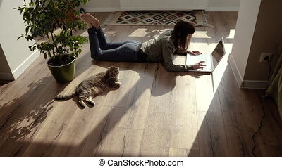 Work at home. Woman works at a laptop at home.
