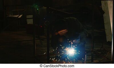 Work at the plant. Electric welder at work. Lots of hot...