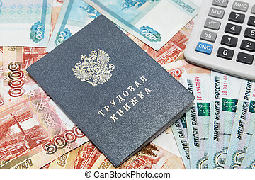 Work-book and calculator on the background of Russian money / Russian translation for: labor book