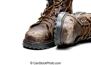 Work Boots - A pair of very worn work boots.