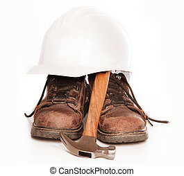 Work boots, hard hat and hammer