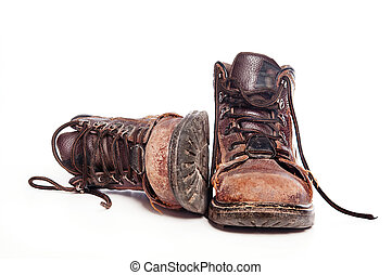 Work boots - Men's rugged boots isolated against white ...