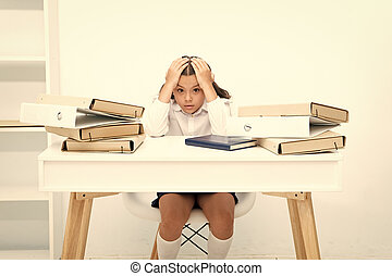 Work concept. Little child stressed with paper work. School girl overloaded with file work. That is too much work for me