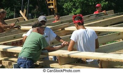 Work Crew Planning - Crew discussing barn planning.