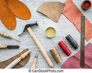Work desk of clobber skin and tools on grey wooden desk pictures