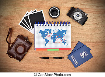 Work desk tourist. Camera, passport, pen and note pad with drawing air travel scheme