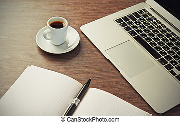 work desk with a cup of coffee computer laptop, notebook, ...