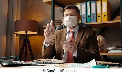 Work during the coronavirus epidemic. A man in a medical ...