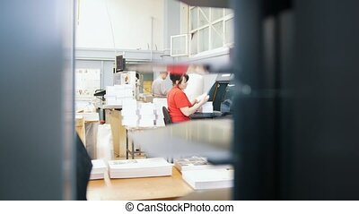 Work flow of people in the publishing printing house, close...