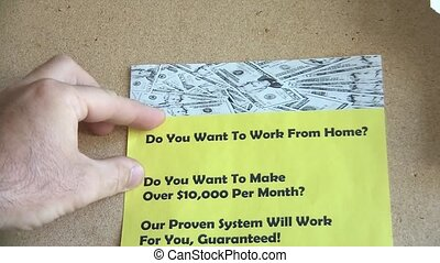 Work from Home Flyer Hung - Hand pins up a yellow work from...