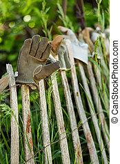 Work gloves - Fence decorated with old work gloves.