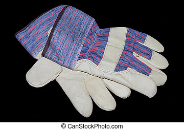 Work Gloves - Image of a pair of work gloves on a black...